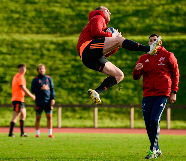 Keith Earls showcases his acrobatic skills during Munster's training session at the University of Limerick yesterday. Photo: Sportsfile