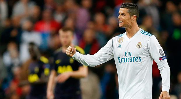 Cristiano Ronaldo clenches his fist in celebration after scoring from the penalty spot. Photo: AP