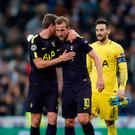 Soccer Football - Champions League - Real Madrid vs Tottenham Hotspur - Santiago Bernabeu Stadium, Madrid, Spain - October 17, 2017 Tottenham's Harry Kane celebrates with Jan Vertonghen and Hugo Lloris after the match Action Images via Reuters/Andrew Couldridge