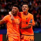 Liverpool's Alex Oxlade-Chamberlain celebrates scoring their sixth goal with Philippe Coutinho. Photo: Reuters