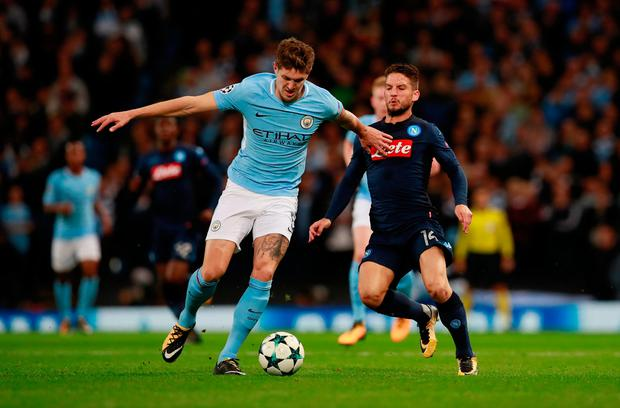 Manchester City's John Stones in action with Napoli's Dries Mertens. Photo: Reuters