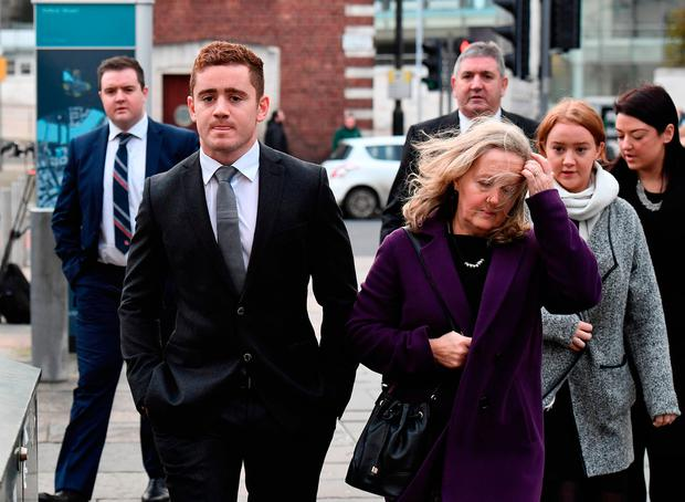 Ireland rugby star Paddy Jackson arrives with family members to Belfast Magistrates Court. Picture: Getty