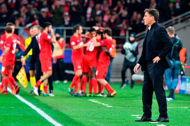 Sevilla's coach from Argentina Eduardo Berizzo looks on as Spartak Moscow's players celebrate after the UEFA Champions League Group E football match between FC Spartak Moscow and Sevilla FC at the Otkrytie Arena stadium in Moscow. Photo: Getty