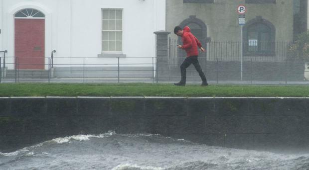 A man walks in the Claddagh area of Galway. While the west did experience rainfall, it did not receive any more than would be typical on a very rainy day. Photo: Andrew Downes