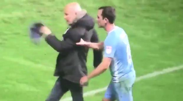 WATCH - Furious Coventry City supporter invades pitch to confront players and is removed by their Irish captain