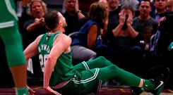 Gordon Hayward #20 of the Boston Celtics is sits on the floor after being injured while playing the Cleveland Cavaliers at Quicken Loans Arena
