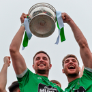 Moorefield captain Daryl Flynn and vice-captain David Whyte lift the Dermot Bourke Cup after beating Celbridge in the Kildare senior football decider last Sunday. Photo by Piaras Ó Mídheach/Sportsfile