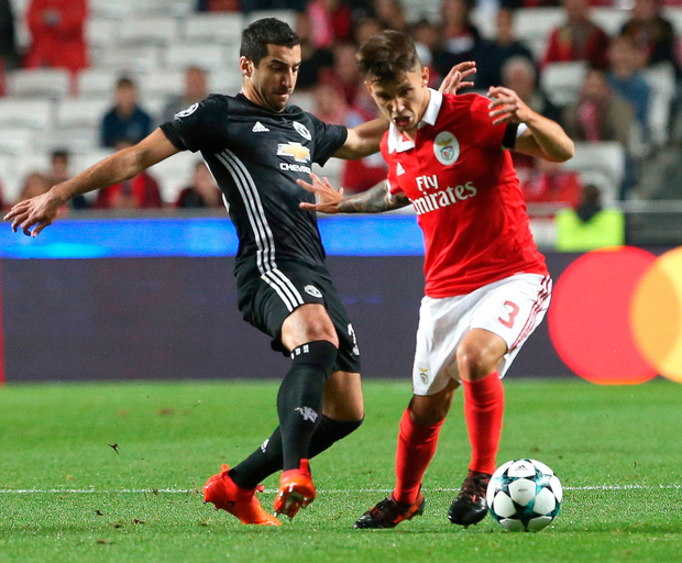 Benfica's Alejandro Grimaldo, right, challengers Manchester United's Henrikh Mkhitarya for the ball during their Champions League clash. Photo: Armando Franca/AP