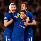Chelsea's Eden Hazard celebrates scoring his side's third goal with Gary Cahill and Marcos Alonso. Photo: John Sibley/Reuters