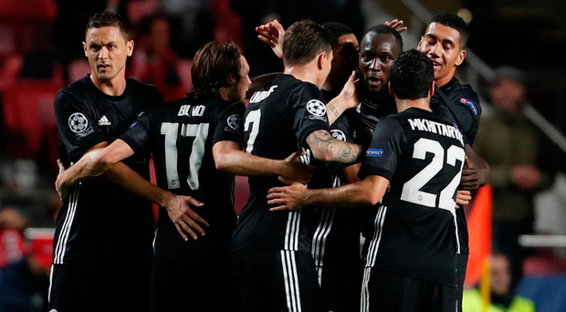 Manchester United's Marcus Rashford celebrates with team-mates after scoring against Benfica at the Stadium of Light, Lisbon last night. Photo: Rafael Marchante/Reuters