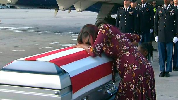 Myeshia Johnson cries over the casket in Miami of her husband, Sgt La David Johnson, who was killed in an ambush in Niger. Photo: WPLG via AP