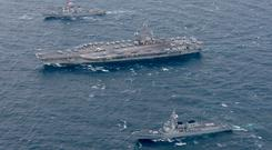 The US Navy's forward-deployed aircraft carrier USS Ronald Reagan and the forward-deployed Arleigh Burke-class destroyer USS Stethem steam alongside ships from the Republic of Korea Navy in the waters east of the Korean Peninsula yesterday. Photo: US Navy