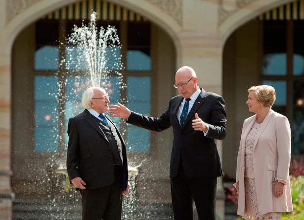 Ireland's President Michael Higgins, left, walks with New South Wales state Governor David Hurley and Deputy Prime Minister of Ireland Frances Fitzgerald, right, on the grounds at Government House in Sydney, Australia, Tuesday, Oct. 17, 2017. (AP Photo/Steve Christo, Pool)