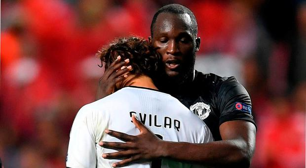 Romelu Lukaku and Mile Svilar embrace after the UEFA Champions League group A match between SL Benfica and Manchester United at Estadio da Luz