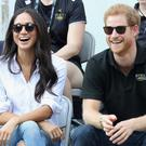 Meghan Markle and Prince Harry, left, and Britain's Queen Elizabeth, right
