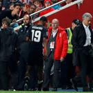 Manchester United's Marcus Rashford leaves the pitch as he is substituted after sustaining an injury last night. Action Images via Reuters/Carl Recine