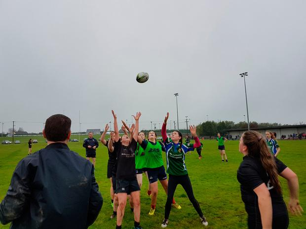 Hands Up! Connemara girls battle for lineoput ball in the air.