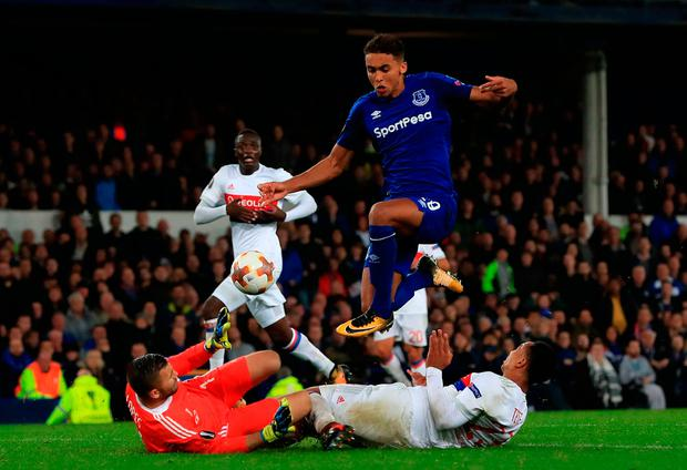 Everton's Dominic Calvert-Lewin leaps over a challenge from Olympique Lyonnais goalkeeper Anthony Lopes and Kenny Tete. Photo: Peter Byrne/PA