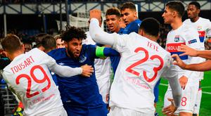 Ashley Williams clashes with Lyon players at Goodison Park. Photo: Ross Kinnaird/Getty Images