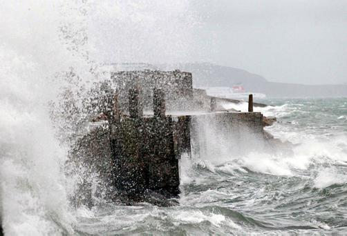 Mounting waves at Dun Laoghaire pier yesterday afternoon. Photo: Stephen Collins/Collins Photos