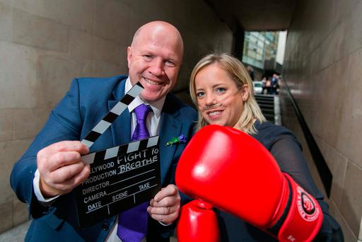 Olympic boxing gold medallist Michael Carruth with CF sufferer Edelle Collins from Castleknock, Dublin, at the launch of a new cinema advertisement for CF Ireland. Picture: SON Photographic