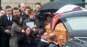 Friends and family, including girlfriend Nollaig Hennessy (centre, holding frame) at the funeral of victim Michael Pyke in Co Tipperary yesterday. Photo: Provision