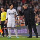 MADRID, SPAIN - DECEMBER 16: Real Madrid CF head coach Jose Mourinho talks with Mesut Ozil of Real Madrid during the La Liga match between Real Madrid CF and RCD Espanyol at estadio Santiago Bernabeu on December 16, 2012 in Madrid, Spain. (Photo by Denis Doyle/Getty Images)