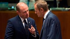 Maltese Prime Minister Joseph Muscat, left, confers with European Council President Donald Tusk during the latest round of Brexit talks yesterday in Brussels. Picture: Getty