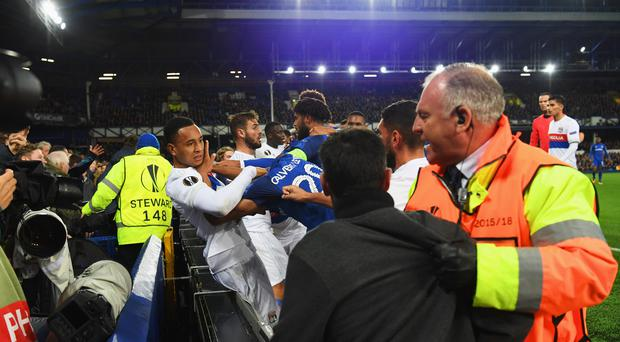 Players clash and fans are restrained after a challenge by Ashley Williams of Everton on Anthony Lopes of Lyon during the UEFA Europa League Group E match between Everton FC and Olympique Lyon at Goodison Park on October 19, 2017 in Liverpool, United Kingdom. (Photo by Ross Kinnaird/Getty Images)