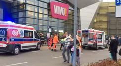 Emergency services transport a victim to an ambulance following an attack at a mall in Stalowa Wola, Poland October 20, 2017 in still this picture taken from social media video. MATEUSZ NYKIEL/via REUTERS