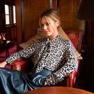 Paul Costelloe Living Studio silk leopard pussy-bow blouse, €90; leather skirt, €150, both available now, exclusive to Dunnes Stores