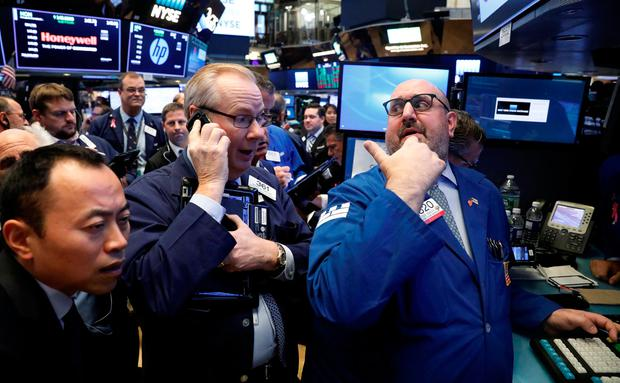 Traders gather for the IPO of Singapore-based Sea Limited on the floor of the New York Stock Exchange (NYSE)
