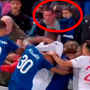 Still images taken from video show the Everton fan with a young child in his arms running towards the fight and lashing out at the Lyon players. Picture: PA