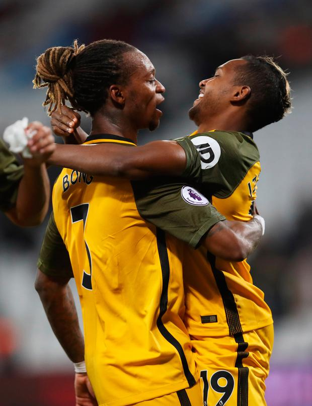 Jose Izquierdo (R) and Gaetan Bong of Brighton and Hove Albion celebrate victory. Photo: Getty Images