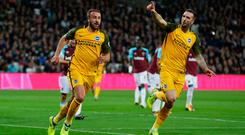 Glenn Murray of Brighton and Hove Albion (L) celebrates as he scores their first goal with Shane Duffy. Photo: Getty Images