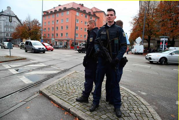 German police officers guard the site where earlier a man injured several people in a knife attack in Munich, Germany, October 21, 2017.