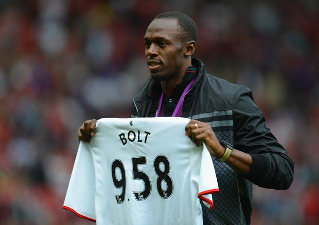 Jamaican Athlete Usain Bolt poses with a United shirt prior to the Barclays Premier League match between Manchester United and Fulham at Old Trafford on August 25, 2012 in Manchester, England. (Photo by Shaun Botterill/Getty Images)