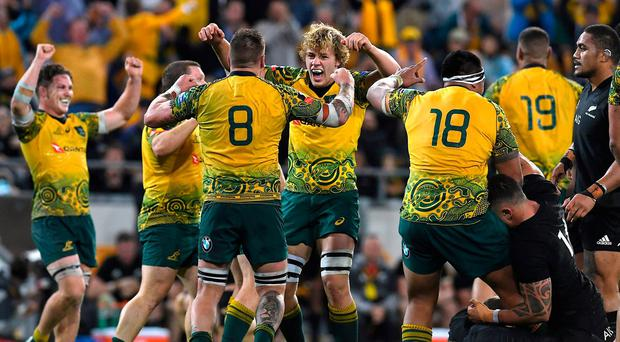 Australian Wallabies players celebrate winning the third Bledisloe Cup rugby union match against the New Zealand All Blacks at Lang Park in Brisbane