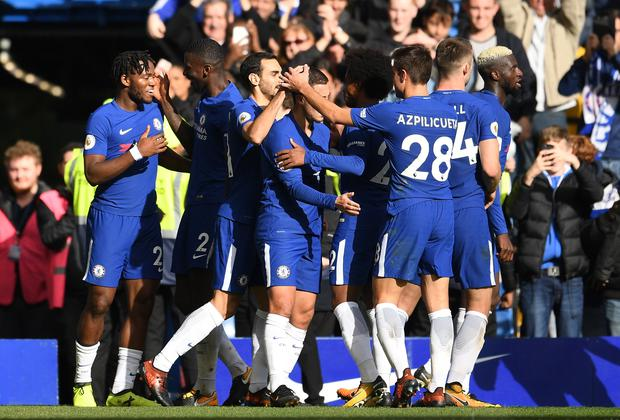 Michy Batshuayi of Chelsea celebrates scoring his second goal, Chelsea's fourth with team mates during the Premier League match between Chelsea and Watford at Stamford Bridge on October 21, 2017 in London, England. (Photo by David Ramos/Getty Images)