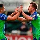 Matt Healy, right, is congratulated by his teammate Cian Kelleher of Connacht after scoring his side's second try during the European Rugby Champions Cup Pool 5 Round 2 match between Connacht and Worcester Warriors at the Sportsground in Galway. Photo by Matt Browne/Sportsfile