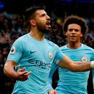 Manchester City's Sergio Aguero celebrates scoring their first goal with Leroy Sane