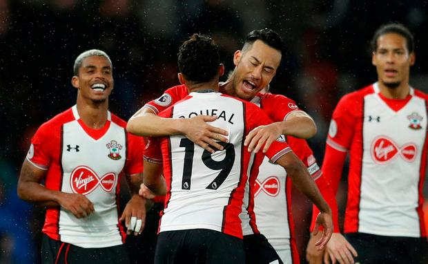 Southampton's Sofiane Boufal celebrates scoring their winner with Maya Yoshida
