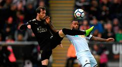 Leicester City's Christian Fuchs clashes with Swansea's Luciano Narsingh Photo: Getty