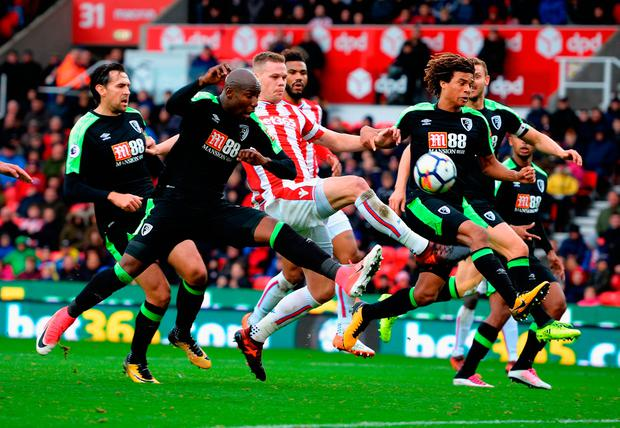 Ryan Shawcross of Stoke City gets between Benik Afobe and Nathan Ake of AFC Bournemouth Photo: Getty