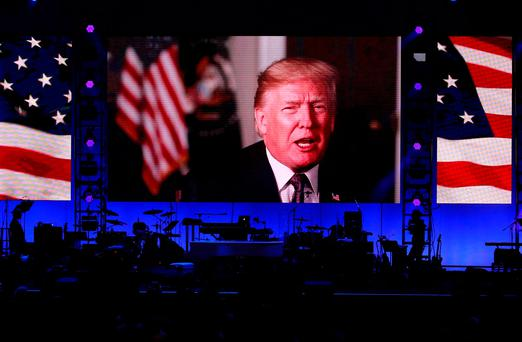 President Donald Trump in a video message as five former U.S. presidents, Jimmy Carter, George H.W. Bush, Bill Clinton, George W. Bush, and Barack Obama attended a concert at Texas A&M University benefiting hurricane relief efforts in College Station, Texas, U.S., October 21, 2017. REUTERS/Richard Carson