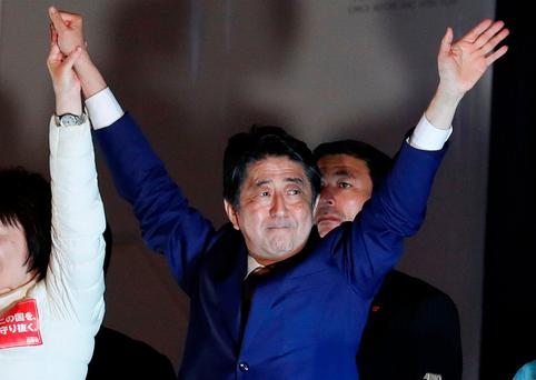 Japan's Prime Minister Shinzo Abe, leader of the Liberal Democratic Party, gestures at an election campaign rally in Tokyo, Japan October 21, 2017. REUTERS/Kim Kyung-Hoon