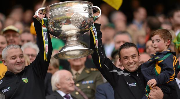 Pat Shovelin, Donegal goalkeeping coach, left, and Maxi Curran, Donegal team video analyst, lift the Sam Maguire in 2012