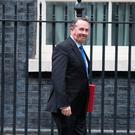 International Trade Secretary Liam Fox outside 10 Downing Street, London, after Theresa May and European Commission President Jean-Claude Juncker agreed to