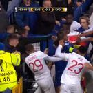 The man appears to throw a punch at Lyon goalkeeper Anthony Lopes. BT Sport