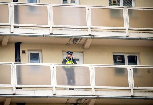A police officer on a balcony at Newcastle House in Bradford, where an 18-month-old baby died following a fall from a sixth-floor window, a 23-year-old woman has been arrested on suspicion of murder in connection with the baby's fall. Danny Lawson/PA Wire